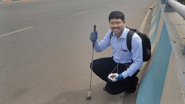 Bengaluru Techie Picking Nails From Bengaluru Roads
